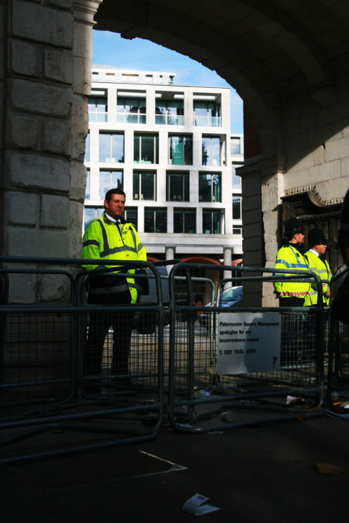 Occupy London protest - Police behind barriers, preventing the protesters from occupying Paternoster Square, the location of the London Stock Exchange. Paternoster Square