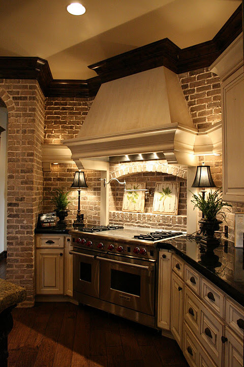 Beautiful Tuscan-style kitchen with distressed ivory cabinets and brick walls (via Le Chateau de L'Amour - Sharla - Picasa Web Albums)