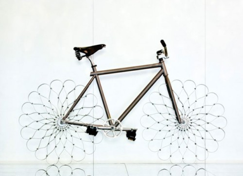 a bicycle with sprung steel wheels.  Via @LaughingSquid.  More info @fastcodesign here. laughingsquid:  Sprung Steel Wheeled Bicycle by Ron Arad   Related articles Steel Wheel Bike!!! (surfabike.wordpress.com) Beautiful Bouncing Bike With Sprung Steel Wheels (wired.com) Ride tirelessly - on bike with steel wheels! (msnbc.msn.com) Steel-wheeled bicycle (holykaw.alltop.com)
