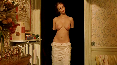 The scene where Isabelle's hair catches fire happened unplanned. Eva Green was supposed to lean forward and kiss Matthew goodnight but accidentally caught her hair on fire on the candle on the table. She didn't let it worry her and acted so natural that Bernardo Bertolucci decided to leave it in as he felt it demonstrated perfectly the cross over in the film that things are about to get a bit crazy!