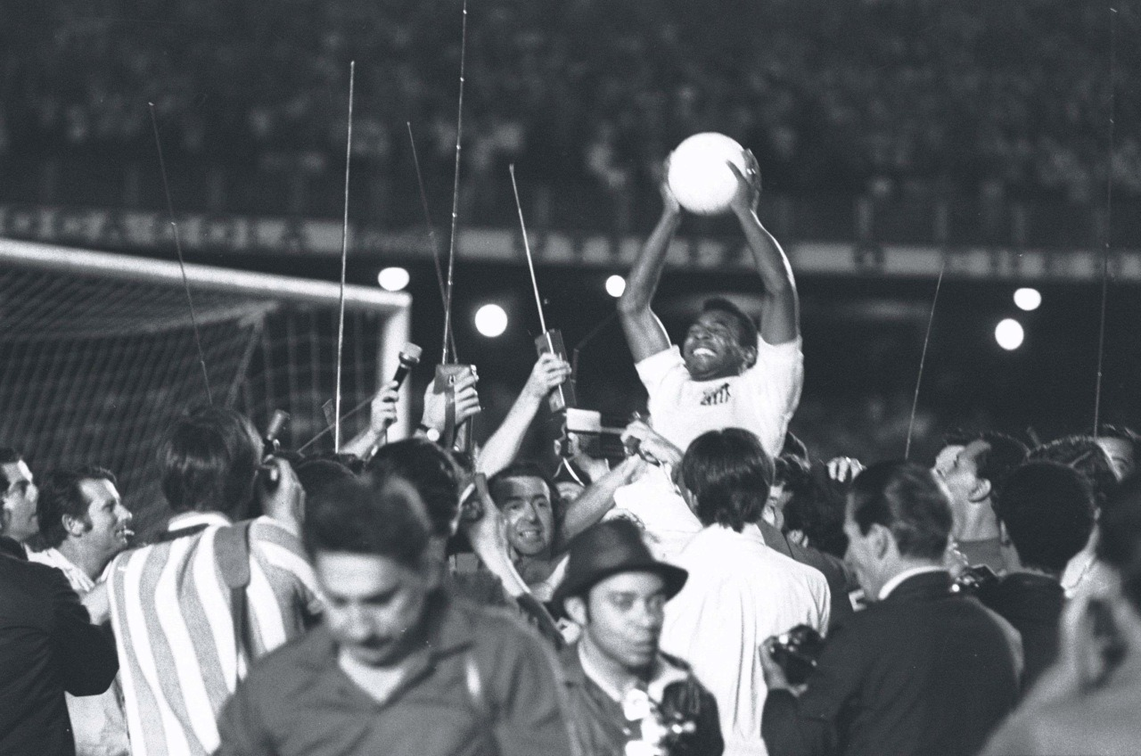 footysphere:  Pele celebrates after scoring his 1000th Goal (check out the video) (via interleaning)  On this day, back in 1969, Pele scored his 1000th goal: a sweetly taken penalty shot for Santos against Vasco da Gama, his 909th game. A pitch invasion ensued. :)