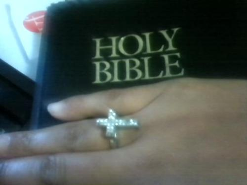 Cross ring over the Holy Bible.