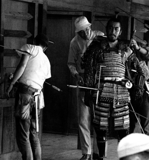 "Akira Kurosawa sets up the shot of Toshiro Mifune's death in Throne of Blood (1957) (via)  ""In order to write scripts, you must first study the great novels and dramas of the world. You must consider why they are great. Where does the emotion come from that you feel as you read them? What degree of passion did the author have to have, what level of meticulousness did he have to command, in order to portray the characters and events as he did? You must read thoroughly, to the point where you can grasp all these things.""  -Kurosawa, Something Like an Autobiography   [via oldhollywood]"