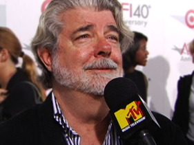 George Lucas joyfully weeps after an interviewer finally brings the microphone up to his mouth, rather than his neck.