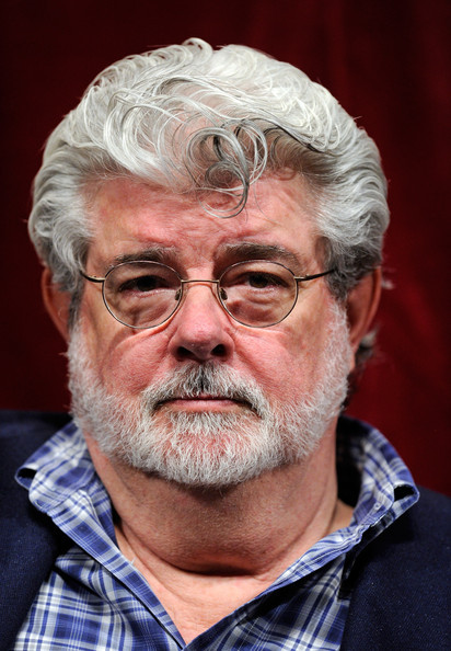 George Lucas struggles to swallow a bean bag.
