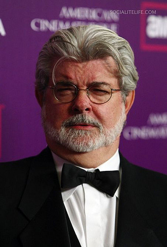 George Lucas trying to swallow his neck through his neck.