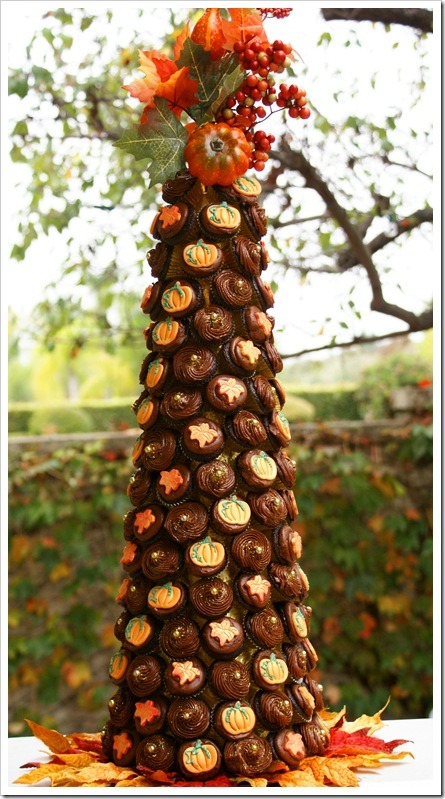 Adorable Fall Mini Cupcake Tree. It's easy! Start with a styrofoam cone and hang the cupcakes onto the tree with toothpicks. Check out the Tutorial here.