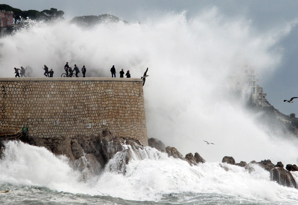 Photos of the day People look at high waves on November 8, 2011, in the southern French city of Nice. (Valery Hache/AFP/Getty Images)