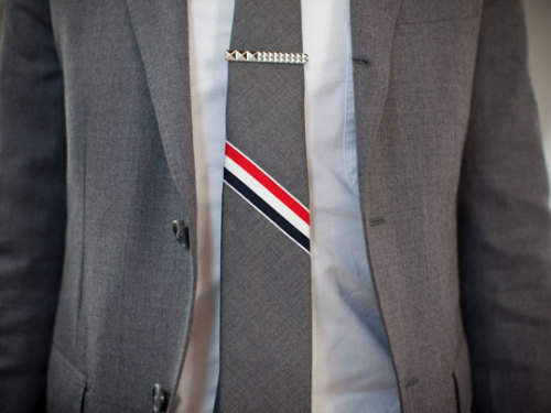 nickelcobalt:  Thom Browne Tie for Fashion Night Out Tokyo   Not only is this a terrible way to wear a tie clip.  It's a terrible tie clip!
