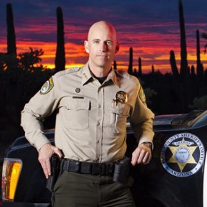 "Pinal County, Arizona Sheriff Paul Babeu (above) is recording robo-calls for Mitt Romney in Iowa. That wouldn't be such a big deal, except that in addition to calling President Obama ""the enemy"" and alleging that his immigration policies ""borderline"" treason, Babeu  has also come under criticism for appearing on a white nationalist talk radio program that's been a frequent platform for white supremacists."