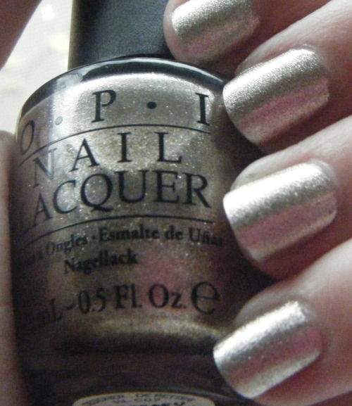 Nail of the Day: 11.9.2011 This polish is Designer…de Better! from OPI's Holiday 2011 Muppets collection. I would describe it as a silvery champagne shimmer that will be great for the holidays. It's opaque in two coats, which I love! I picked this bottle up at a local salon about a month ago, but I've been told Ulta has the Muppets collection in stock now as well. I've been reading a lot of nail polish blogs lately, and it seems the Muppets Collection is a hit or miss with most. I'm kind of on the fence with the collection as a whole. I purchased 4 of the 12 polishes, all of which I'm quite happy with. I agree that the collection is not the most holiday-inspired, and some of the colors are similar to other OPI polishes (the deep reds and plums). But Designer…de Better! is one of my favorites. What do you think of the collection? Designer…de Better!: 2 coats