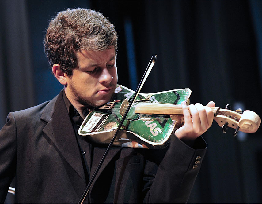 "A violinist of Paraguayan symphonic orchestra ""Trash Melodies"", whose musicians play instruments made out of recycled materials, performs in Asuncion on July 28, 2011. The NGO ""Sounds of Earth"", led by classic musician Luis Szaran, encouraged Paraguayan luthier Nicolas Orue, known as ""don Kola"", to keep on making such instruments, whose sound have amazed the public. In Focus: Recycling Around the World"