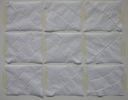 9 Pieces of A5 Paper, Rolled, Folded, Unfolded and Unrolled, 2011 Paper and Masking Tape