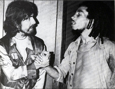 This classic photo of George Harrison  and Bob Marley was taken on July 13, 1975, backstage at the Roxy Theatre in Los Angeles, California.