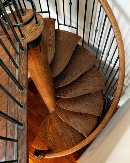 When the front door opens - this is a wow. This lovely spiral acts as a design anchor in this nautically designed beachfront cottage. Wave pattern treads and bronzed balustrade and metalwork complete the look. (via Nautical Spiral - eclectic - staircase - seattle - by Seattle Stair & Design)