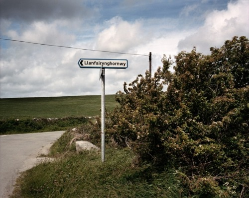 "ohmedusa:  A road sign on the way to Borth Beach illustrates Wales's seemingly unpronounceable place-names. Anglesey has the distinction of having the railway station with the longest name in Britain, possibly the whole world: Llanfairpwllgwyngyllgogerychwyrndrobwllllantysiliogogogoch,  which translates as ""St. Mary's church in the hollow of the white hazel near a rapid whirlpool and the church of St. Tysilio of the red cave."""