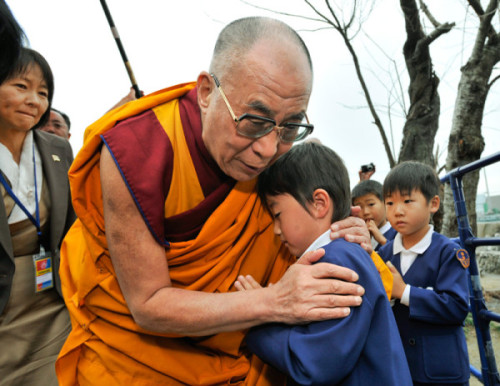themarchio:  His Holiness the 14th Dalai Lama, comforts a young boy who lost his parents to the tsunami last March in Japan.