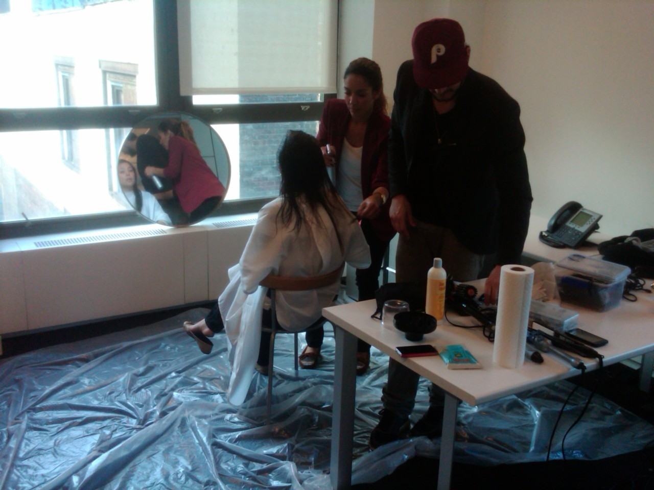 Director of content Mollie Chen getting her hair cut at BB HQ by stylist Mike Viggue and his assistant stylist, Amanda Pabon.  Birchbox is officially the best place ever to work. Not only do we get to try tons of fun beauty products and interact with incredibly smart and motivated people each day, but we even have renowned hair stylists come to the office to cut hair. It doesn't get better than this. —Meredith