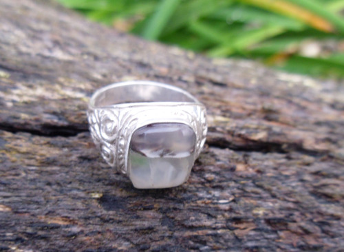 Symphony in Grey: A gents sterling silver ring set with a gorgeous agate in grey and  black.  A natural flaw runs through the middle of the agate, making it  more dramatic. Symphony in Grey