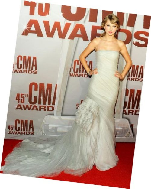Country star and 'Entertainer of the Year' Taylor Swift looks stunning at the 45th annual CMA Awards in Nashville, Tennessee. Click the photo for other gorgeous Cotton Candy celebs. CottonCandyMag.com