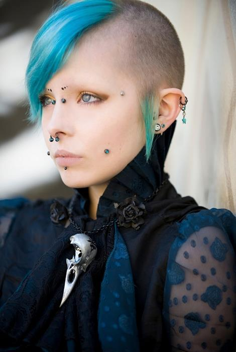 Wow! Colourful and gothy! -> Bridge, cheeks, labret, septum, dermals, lobes, helix …  http://piercingprincess.tumblr.com/