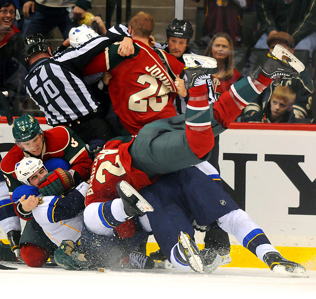 Wild center Kyle Brodziak gets pulled down by Blues defenseman Roman Polak who is in the grips of Wild defenseman Marek Zidlicky during a fight at the end of thje second period of Saturday's game. Minnesota beat St. Louis, 2-1. (Vincent Muzik/Icon SMI) ELIOT: A strong Blues not runs through this college coach success storyHACKEL: The most impressive players one month into the NHL season
