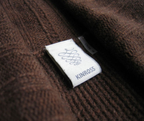 Kinross Cashmere Kinross has been producing high-quality Scottish cashmere  for over 100 years, but in order to move their business out of a  manufacturing mentality, and into the realm of fashion, they needed to  rebuild their brand strategy from the ground up.  To accomplish this, we returned to their core strengths: their history  as the first commercial producers of cashmere in the world; and the  quality of their product. The inspiration for the symbol was drawn from the complex process of refinement it takes to create Kinross cashmere.  From hand-combing the fiber from the fine downy hair beneath the goat's  thick exterior coat, it is a long and detailed journey from goat to  garment.