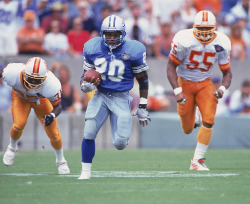 siphotos:  Lions RB Barry Sanders breaks free during a 1994 game against the Buccaneers. Sanders' son, Barry Jr., is currently blazing his own path for Heritage Hall High School in Oklahoma City. (John Biever/SI) GLICKSMAN: Barry Sanders Jr. driven to create his own legacy