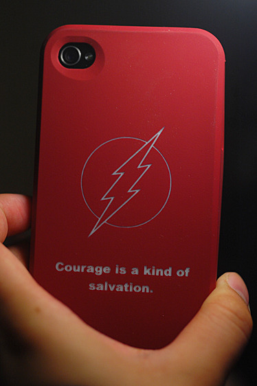 "So I jumped on that Slickdeals deal of $5 for a custom engraved iPhone case. This is my favorite shade of red, which partially explains why seeing Impulse when I was a young'un was ""OMG INSTANT ATTRACTION 833333!!!"" so I figured it'd be suiting to throw a Flash logo on it as a subtle mix of Bart elements. I could have left it simple and elegant with just that, but no I had to engrave something because it was possible just to see how it'd look. Thinking back on it, should have just left it as the Flash logo! Oh well."
