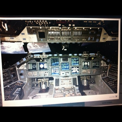 Space shuttle cockpit control photo +earth in background.. +noticeable 11's (Taken with instagram)