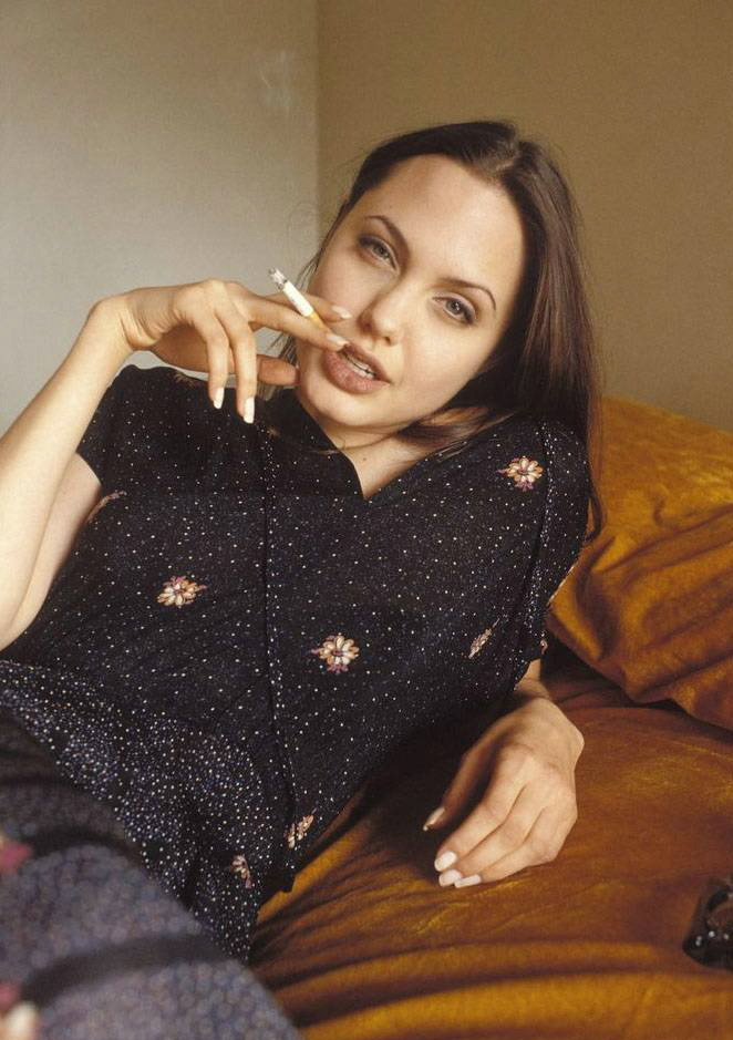Angelina Jolie, 19 years old, photographed by Michel Bourquard