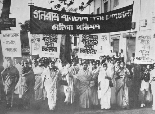 "lotus-eyes:  Rally led by poetess Sufia Kamal  Sufia Kamal (Bangla: সুফিয়া কামাল) (June 20, 1911-November 20, 1999) was a poet, writer, organizer, feminist and activist from Bangladesh. She was born to a Muslim family in Barisal, Bangladesh. She is one of the most widely recognized cultural personalities in Bangladesh. When she died in 1999, she was buried with full state honors, the first woman in Bangladesh to receive this honor. Shewas born in Shaestabad, daughter of a distinguished zamindar family, in Barisal. During her childhood, women's education was prohibited and she could not afford to get academic education. But she learnt Bangla, Hindi, English, Urdu, Arabic, Kurdish and Persian language from her house tutors. In 1918, she went to Kolkata with her mother where she came to meet with Begum Rokeya. She was first married at the age of 11 to her cousin Syed Nehal Hossain, then a law student. They had a daughter, Amena Kahar, and Mr. Hossain died in 1932. Five years later, Ms. Kamal married Kamaluddin Ahmed. In addition to her first daughter, Ms. Kamal is survived by two other daughters, Sultana Kamal and Saida Kamal; two sons, Shahed Kamal and Sajed Kamal; three grandsons, three granddaughters and four great-grandchildren. A short story ""Shainik Bodhu"" which she wrote was published in a local paper in 1923. She came across prominent South Asian personalities, such as Begum Rokeya, Kazi Nazrul Islam, and Mahatma Gandhi. Rokeya, who can be regarded the first female feminist of Bengal, had a lasting impression on her. Sufia Kamal's first poem, Bashanti (Of spring), was published in the then influential magazine, Saogat in 1926. In 1931 she became the first Bengali Muslim female to be the member of Indian Women Federation."