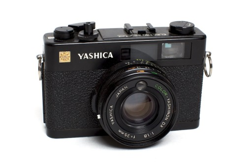 priyapuri:  Yashica Electro 35 CC POTPURI Interesting Finds I would rather like one of these.  kevinhansonphotography:  Yashica Electro 35 CC November 10, 2011Taken with Canon 5DII This is the perfect film camera to carry everywhere with you. It has a very sharp 35mm f/1.8 lens, aperture priority mode (auto exposure), manual rangefinder focusing and is quite compact. It was produced from about 1970 to 1975 and although not common, can easily be found on ebay. This is one of the first rangefinder cameras I picked up and the one that really got me excited about the accuracy manual focusing provides. When loaded with 1600iso film (or 400iso film you plan to push to 1600iso) and set to f/1.8 it can take pictures in most lighting situations. For all those looking to start (or restart) shooting film, I would highly recommend this camera.