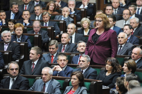 notentirely:   thedailywhat: Anna Grodzka, Europe's first transsexual MP, introduces herself to her new colleagues at the lower house of the Polish parliament. To her left is Robert Biedron, Poland's first openly gay lawmaker.  slowly but surely… slowly, but surely.