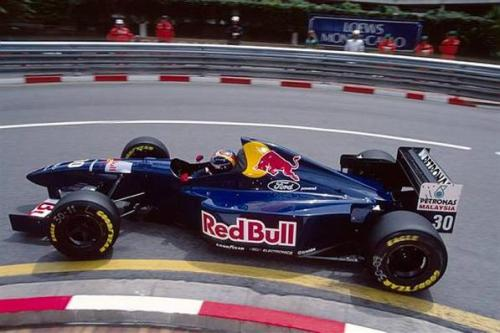 Red Bull Racing RB95? No, it is Sauber's 1995 car, the Sauber C14. Seen here driven by Heinz Harold Frentzen at Monaco. He would finish 9th in the championship with 15 of the team's 18 points, helping them to 7th in the championship. Red Bull and Sauber remained close partners until 2005 when they split with the Austrian drinks company purchasing British team Jaguar Racing. Frentzen would go on to join Williams in 1997 but played second fiddle to team-mate Villeneuve, winning only one race at Imola that year. His 1999 season would go on to be much more successful, winning 2 races and finishing third in the championship. He would finish his career in 2003 with a return to his alma mater, Sauber.