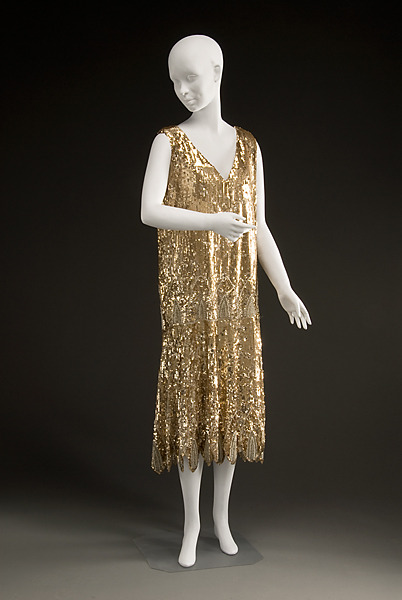 Evening dress, 1925-27, Historic Deerfield Museum That's all sequins, pearls and glass beads.  Not sure how much I like it but geez