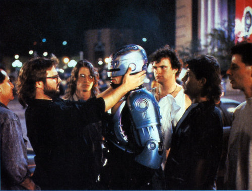 Special FX artist Dennis Pawlik adjusts Peter Weller's helmet on the set of Robocop 2 Become a fan of GeekRest