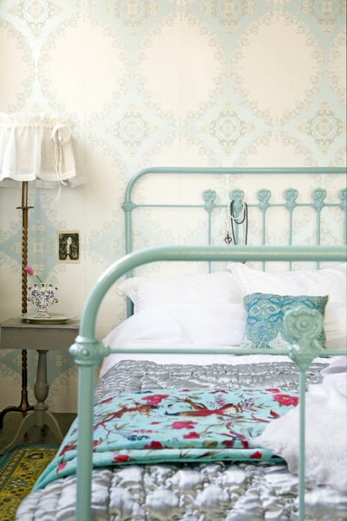 This is such a pretty, delicate and feminine bedroom space, with a subtle wallpaper in aqua and cream, and an old iron bed painted a soft turquoise hue. (via furniture, accouterment, house stuff… / Gorgeous bed and colours)
