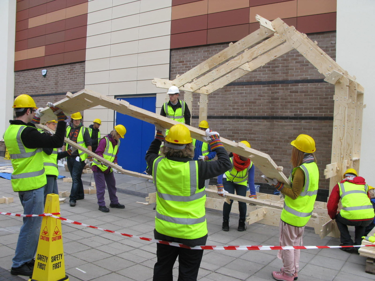 Students of Anglia Ruskin University assembling a WikiHouse in Chelmsford town centre.