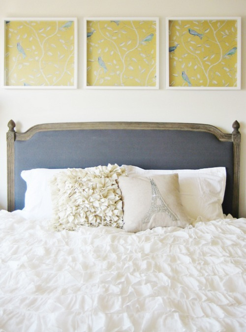 An elaborately ruffled bedcover and framed fabric artwork with birds adds a subtle feminine touch to this bedroom (via danielle oakey interiors)