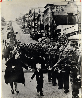 Wait for me, Daddy. Province photographer Claud Detloff captured this iconic image of Warren Bernard, 5, reaching for his father Private Jack Bernard of  the Duke of Connaught's own Rifles as soldiers marched off to war in New Westminster in June 1940.