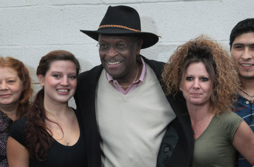 Herman Cain woos the 80s hair band vote campaigns in Michigan (Scott Olson/Getty Images)