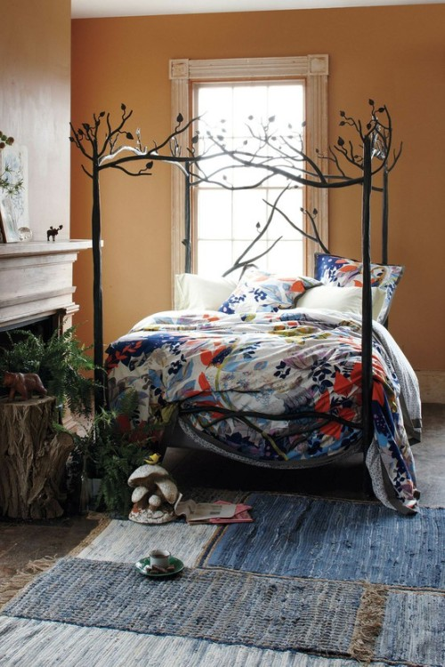 "cajunmama:  Oh, that is gorgeous.  I would never leave that bed. interiorstyledesign:  Love this tree branch ""Forest Canopy"" bed, and the little woodland decorative accents (via Anthropologie.com)"