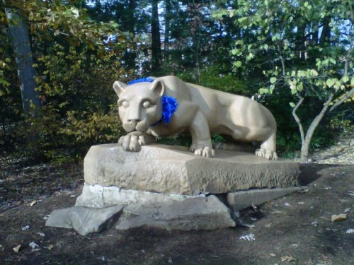 A blue ribbon has been placed around the Nittany Lion at the Lion Shrine, in support of victims of child sexual abuse