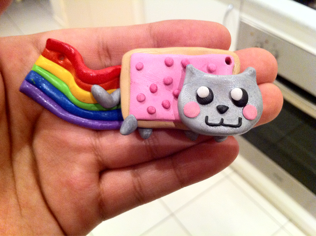 Nyan cat necklace is now available in my store :-) http://www.etsy.com/shop/DarkNLightCreations