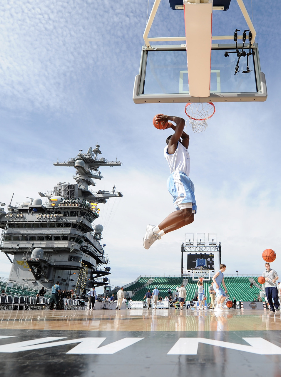 In the navyHarrison Barnes of the North Carolina Tar Heels goes in for a dunk in practice during the Quicken Loans Carrier Classic on board the USS Carl Vinson on November 11, 2011 in Coronado, California. The Tar Heels play the Michigan State Spartans aboard the U.S. Navy aircraft carrier Friday night. Photo: Harry How/Getty Images