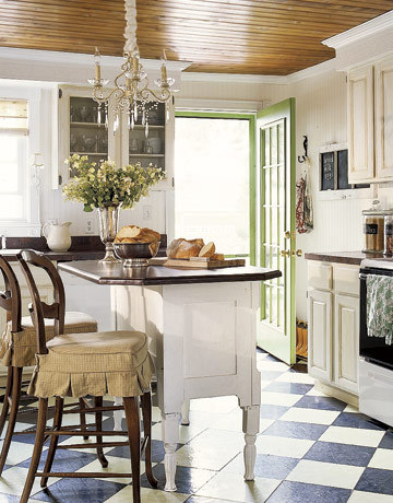 Charming country kitchen with subtle green touches in a black, white, and wood color scheme (via Kitchen Color - Paint and Color Ideas for Kitchens - Country Living)