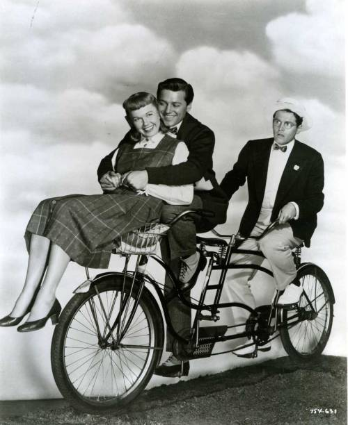 ridesabike:  Doris Day, Gordon MacRae and Jack Smith ride a bike.
