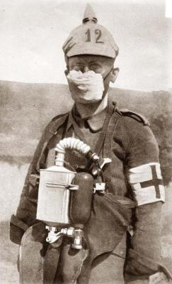 "biomedicalephemera:  German medic in early-WWI gas mask The first ""masks"" to protect against the deadly gasses such as chlorine (as they could actually result in fatalities, unlike the earliest gasses, which were only lachrymatory agents), were no more than damp cloths placed over the nose and mouth. It was believed that dampening the cloths with concentrated urine was more effective than simple water. As the war went on, masks naturally got better, and easier to put on, so the effectiveness of gas weapons decreased significantly.  Wow, that filter looks like it inspired the Medigun/pack on TF2's Medic pretty directly.  Very cool."