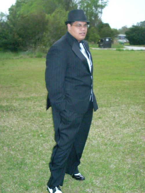 fatpeopleofcolor:  Me dressed up for my Prom.  [image description: Mixed Black male in a pinstripe zoot suit type feel with classic black and white shoes, a fedora hat, and silver tie. He has glasses on, and is standing in what looks like an empty grass field probably outside of the prom location.] Mod note: 1920's swag. - Dan Submitted by: prettycoolblackguy